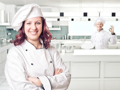 smiling young woman chef portrait